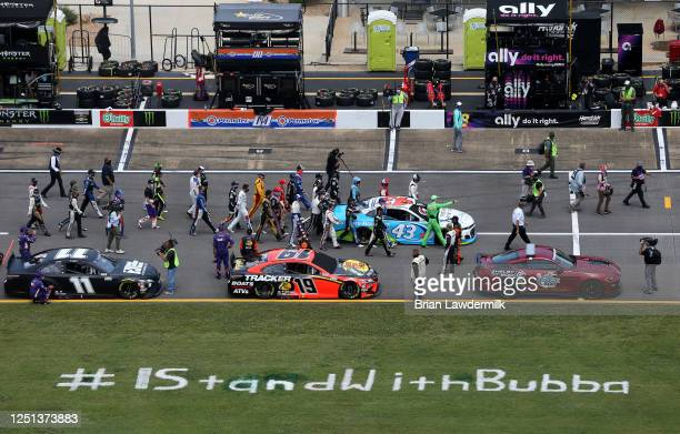 NASCAR drivers push the Victory Junction Chevrolet driven by Bubba Wallace to the front of the grid as a sign of solidarity with the driver prior to...