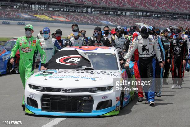 Drivers push the Victory Junction Chevrolet, driven by Bubba Wallace, to the front of the grid as a sign of solidarity with the driver prior to the...