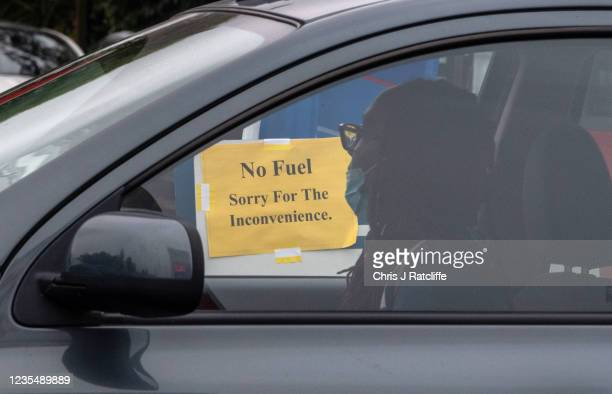 Drivers queue for fuel at an Esso garage on September 25, 2021 in Grove Park, London, United Kingdom. BP and Esso have announced that its ability to...