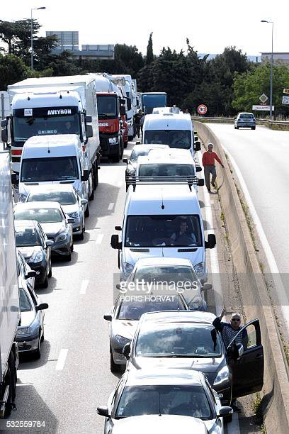Drivers queue on May 19 2016 as striking lorries drivers block the road ahead to protest against the controversial labour reform bill on May 19 2016...