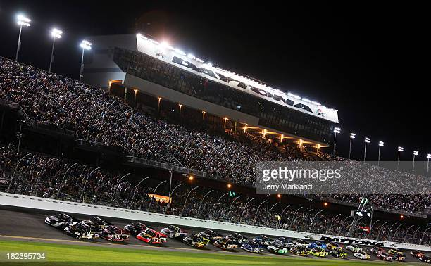Drivers race during the NASCAR Camping World Truck Series NextEra Energy Resources 250 at Daytona International Speedway on February 22 2013 in...