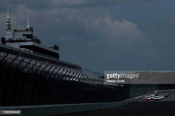 Drivers race in front of the empty spectator grandstand during the NASCAR Xfinity Series Pocono Green 225 Recycled by J.P. Mascaro & Sons at Pocono...