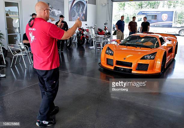 Drivers receive guidance from Matthew Carrick of the Gumpert Racing Team while sititng in a Gumpert Apollo supercar at Monticello Motor Club in...