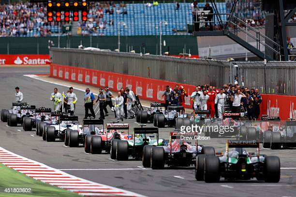 Drivers return to the grid for a restart after the race was redflagged following a collision during the British Formula One Grand Prix at Silverstone...