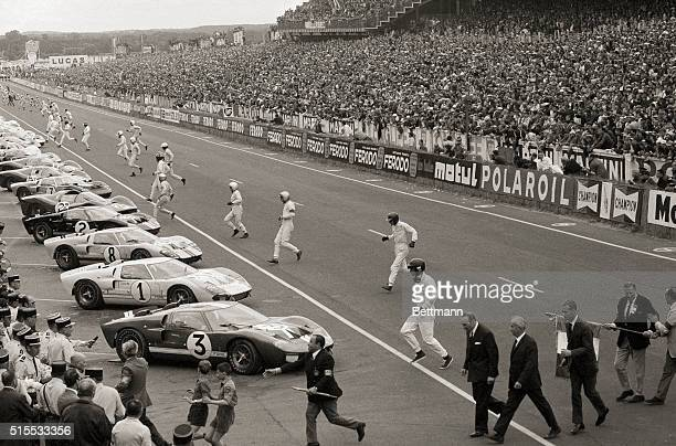 Drivers run to their cars at the start of the 24 Hours of Le Mans race, at the Circuit de la Sarthe, in Le Mans, France, 18th June 1966. The four...