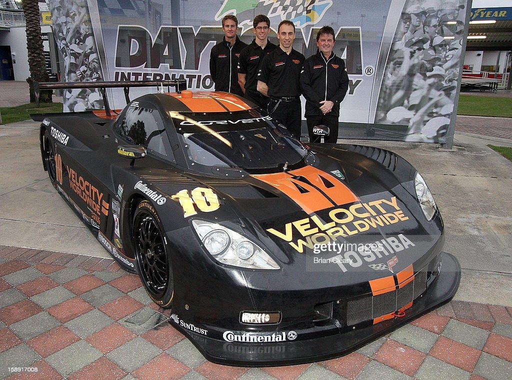 Drivers Ryan Hunter-Reay, Jordan Taylor and Max Angelelli and car onwer Wayne Taylor pose the #10 Wayne Taylor Racing Velocity Worldwide Corvette Dallara DP after a press conference announcing Velocity Worldwide as the team's new sponsor at Daytona International Speedway on January 3, 2013 in Daytona Beach, Florida.