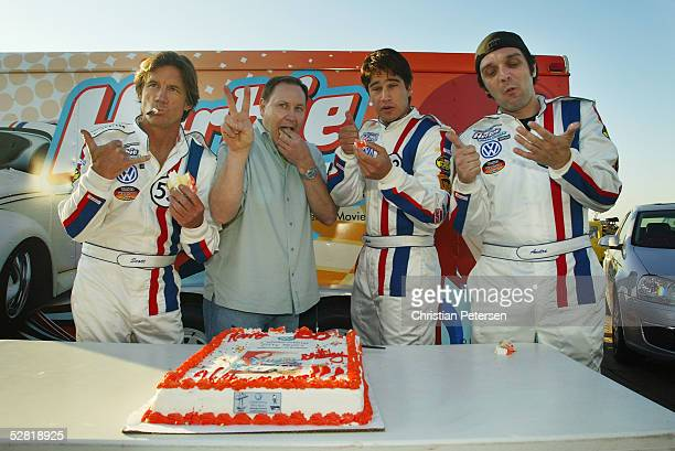 Drivers Scott Dempster Clark Cambell of VW Amir Benakocote and Andre Toselli eat cake before the Ceremonial Launch of Herbie and friends at the Santa...