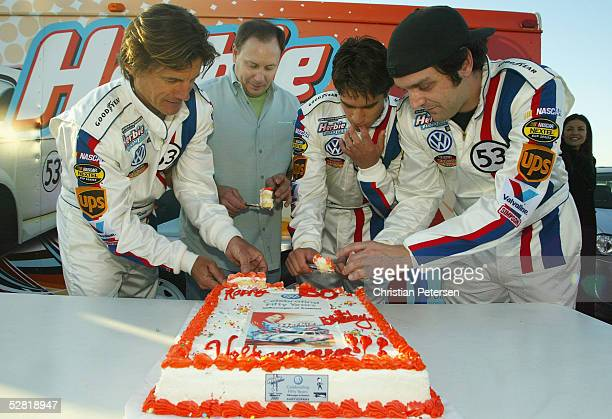 Drivers Scott Dempster Clark Cambell of VW Amir Benakote and Andre Toselli cut the cake before the Ceremonial Launch of Herbie and friends at the...