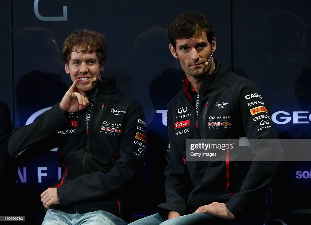 Drivers Sebastian Vettel of Germany (L) and Mark Webber of Australia talk to the guests during the Infiniti Red Bull Racing RB9 launch on February 3, 2013 in Milton Keynes, England.