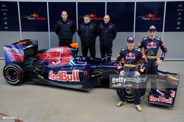 Drivers Sebastien Bourdais and Sebastien Buemi of team Toro Rosso pose with the team principle Franz Tost , technical director Giorgio Ascanelli and...