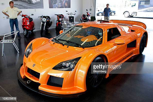 Drivers sit in a Gumpert Apollo supercar before driving on the track at Monticello Motor Club in Monticello, New York, U.S., on Sunday, July 11,...