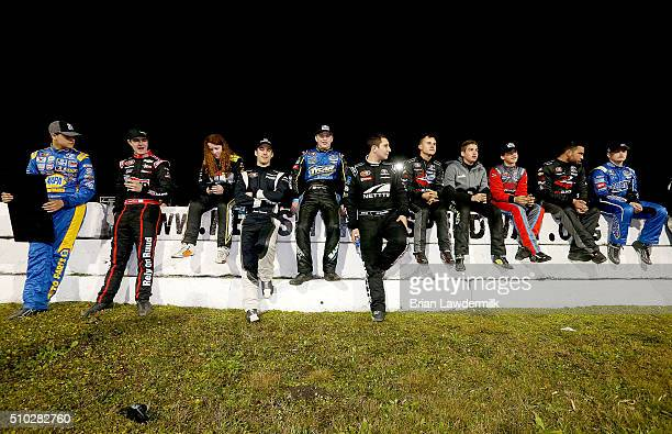 Drivers sit on the pit road wall prior to the start of the NASCAR KN Pro Series East Jet Tools 150 at New Smyrna Speedway on February 14 2016 in New...