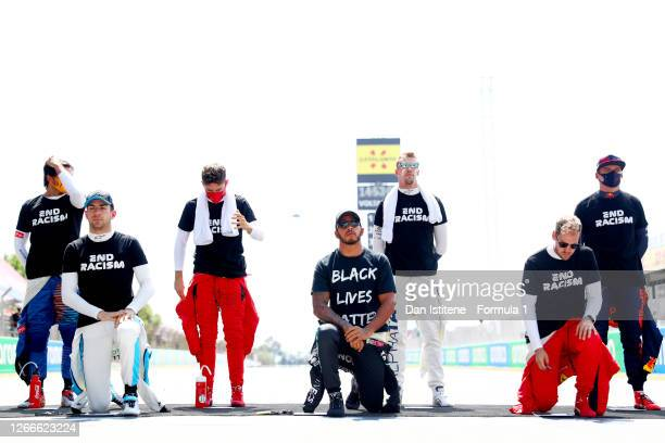 F1 drivers stand and kneel in support of ending racism on the grid before the F1 Grand Prix of Spain at Circuit de BarcelonaCatalunya on August 16...