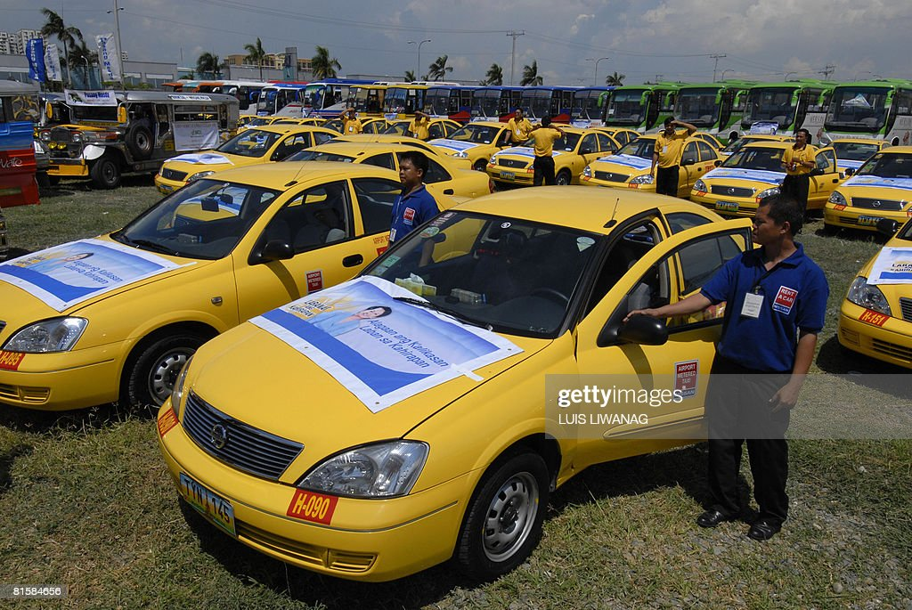 Drivers stand beside modified taxis and : News Photo