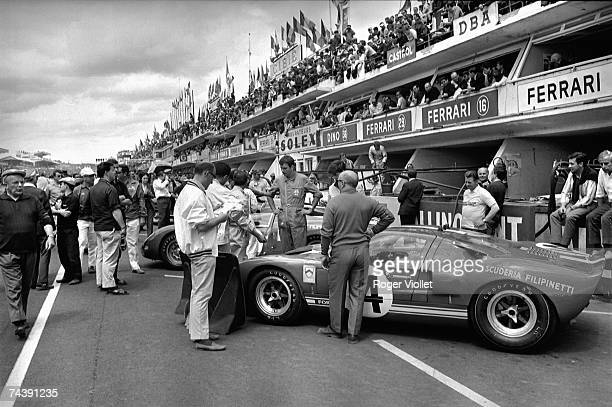 Drivers stand by their cars before the start of the 24 Hours race of Le Mans at Circuit de la Sarthe on June 18 1966 in Le Mans France