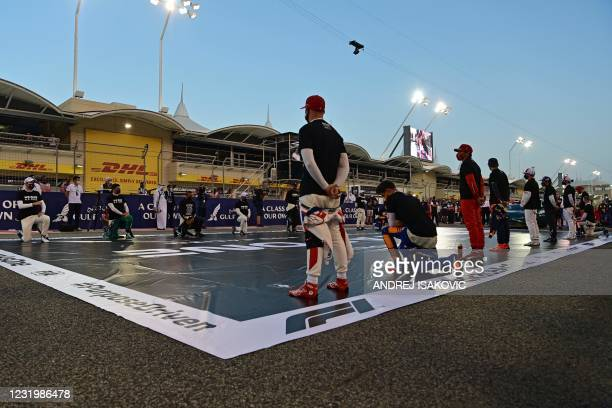 Drivers stand on the grid against racism ahead of the Bahrain Formula One Grand Prix at the Bahrain International Circuit in the city of Sakhir on...