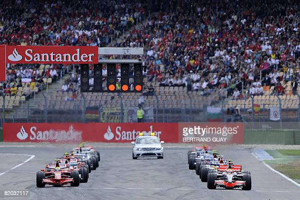 Drivers stand on the grid of the Hockenheim ring racetrack on July 20 2008 in Hockenheim before the start of the German Formula One Grand Prix AFP...