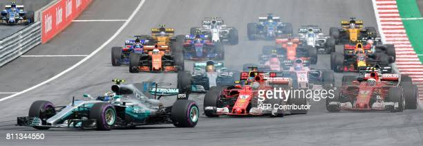 Drivers steer their cars after the start during the Formula One Austria Grand Prix at the Red Bull Ring in Spielberg on July 9 2017 / AFP PHOTO / APA...