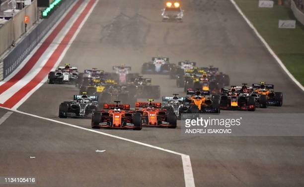 Drivers steer their cars after the start of the Formula One Bahrain Grand Prix at the Sakhir circuit in the desert south of the Bahraini capital...