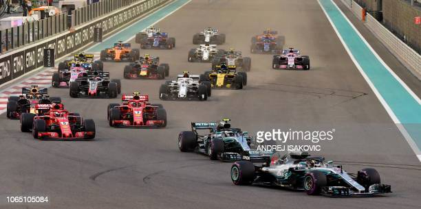 Drivers steer their cars at the start of the Abu Dhabi Formula One Grand Prix at the Yas Marina circuit on November 25 in Abu Dhabi
