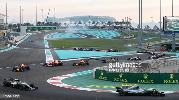 Drivers steer their cars during the Abu Dhabi Formula One Grand Prix at the Yas Marina circuit on November 26 2017 Valtteri Bottas survived several...