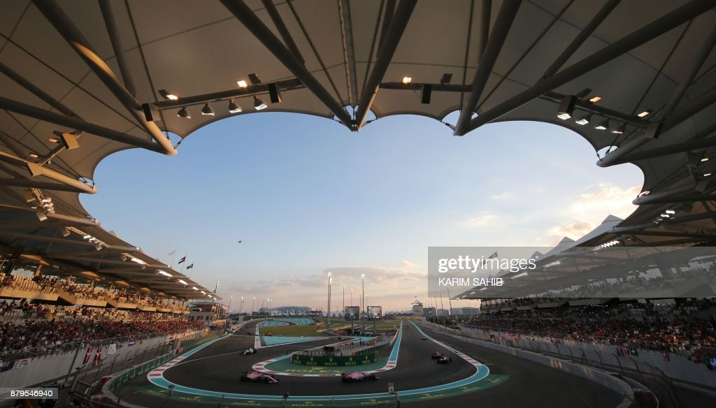 TOPSHOT - Drivers steer their cars during the Abu Dhabi Formula One Grand Prix at the Yas Marina circuit on November 26, 2017. Valtteri Bottas survived several laps of high-speed pressure from his Mercedes team-mate and world champion Lewis Hamilton to claim a memorable victory in the season-ending Abu Dhabi Grand Prix. /