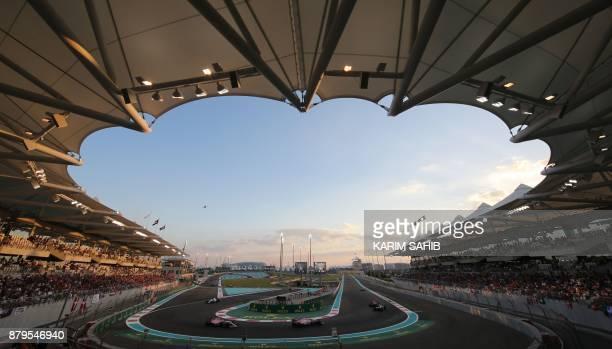 Drivers steer their cars during the Abu Dhabi Formula One Grand Prix at the Yas Marina circuit on November 26, 2017. Valtteri Bottas survived several...