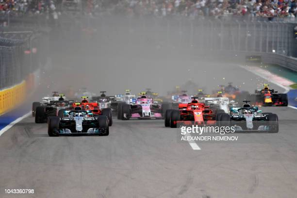 TOPSHOT Drivers steer their cars during the first lap of the Formula One Russian Grand Prix at the Sochi Autodrom circuit in Sochi on September 30...
