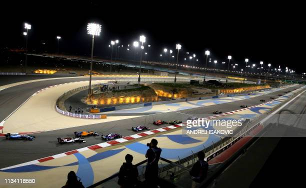 TOPSHOT Drivers steer their cars during the Formula One Bahrain Grand Prix at the Sakhir circuit in the desert south of the Bahraini capital Manama...