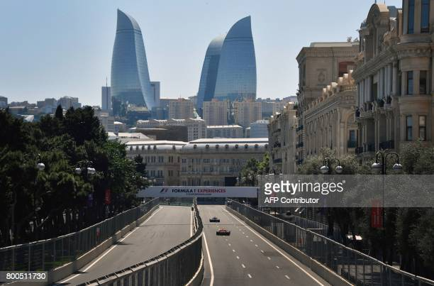 TOPSHOT Drivers steer their cars during the third practice session of the Formula One Azerbaijan Grand Prix at the Baku City Circuit in Baku on June...
