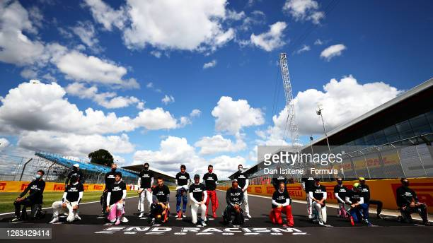 F1 drivers take a knee on the grid in support of the Black Lives Matter movement prior to the F1 Grand Prix of Great Britain at Silverstone on August...