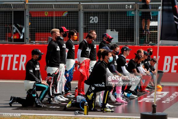 Drivers take a knee to protest against racism ahead of the F1 70th Anniversary Grand Prix at Silverstone on August 9 2020 in Northampton This...