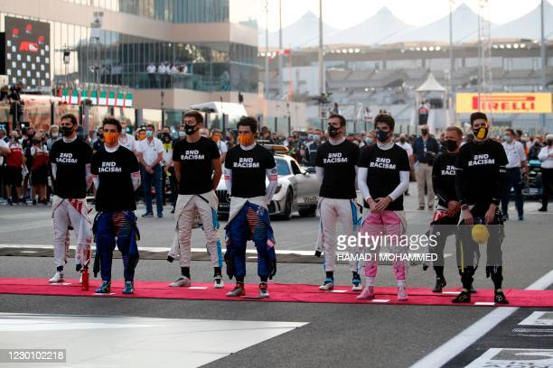 Drivers take part in the End Racism event ahead of the Abu Dhabi Formula One Grand Prix at the Yas Marina Circuit in the Emirati city of Abu Dhabi on...