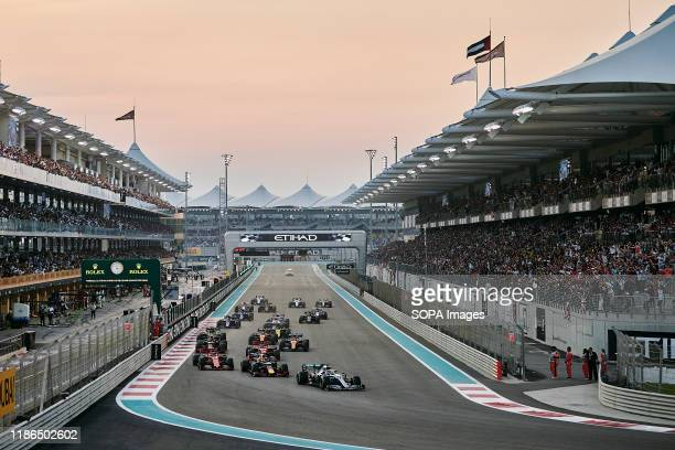 Drivers take the first turn during the opening lap of the Abu Dhabi F1 Grand Prix race at the Yas Marina Circuit in Abu Dhabi.