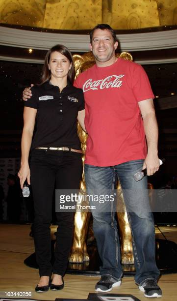 NASCAR drivers Tony Stewart and Danica Patrick attend a meet and greet with NASCAR fans at the MGM Grand Hotel/Casino on March 9 2013 in Las Vegas...