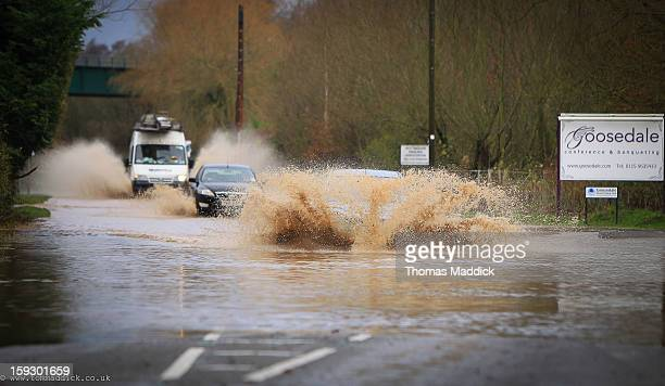 Drivers underestimate the depth of flood water during the winter floods that effected most of the UK. The water washes over the bonnet of an elderly...