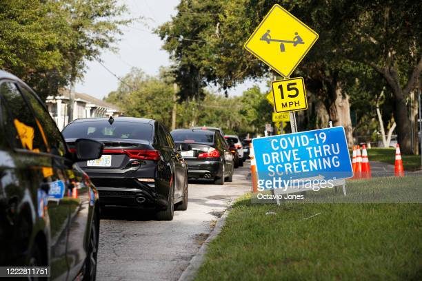 Drivers wait in line to be tested for the coronavirus at the Lee Davis Community Resource Center on June 25 2020 in Tampa Florida The USF Health...