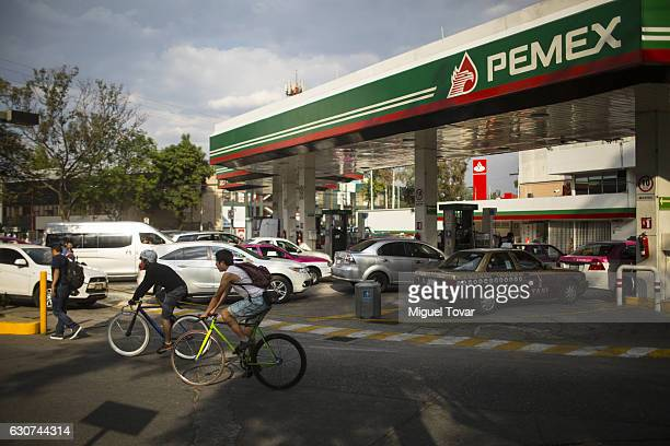 Drivers wait in line to fill up at a gas station in Copilco avenue on December 31 2016 in Mexico City Mexico Officials say it's time for Mexicans to...