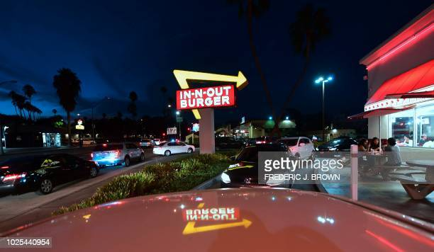 Drivers wait in the drivethru line at an InNOut Burger restaurant in Alhambra California on August 30 2018 California's Democratic Party Chairman...