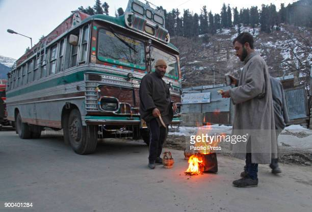 Drivers warm themselves on an early morning at Pahalgam the famed tourist resort in south Kashmir district of Anantnag 100 Km south of Srinagar The...