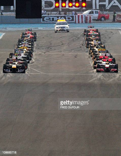 drives at the Yas Marina circuit on November 14 2010 in Abu Dhabi during the Abu Dhabi Formula One Grand Prix AFP PHOTO / FRED DUFOUR