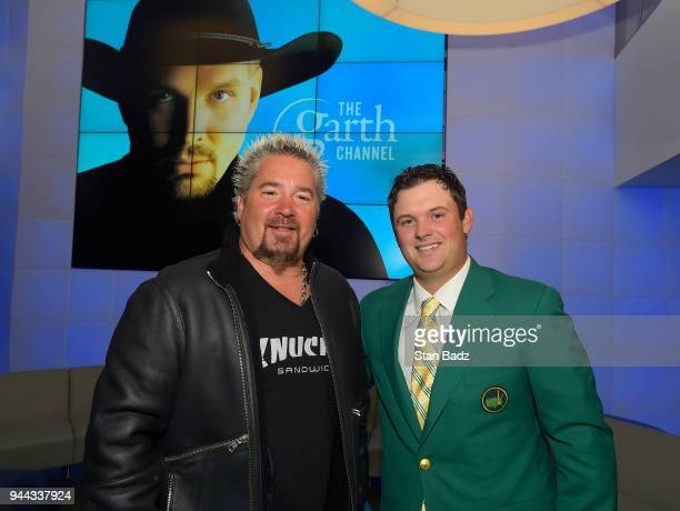 Drives dives and diners TV host Guy Fieri and Masters Champion Patrick Reed pose for a photo at Sirius Radio during the Masters winner media tour...