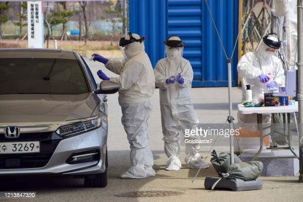 drive-through screening clinic - south korea stock pictures, royalty-free photos & images