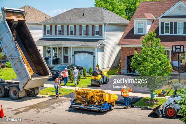 driveway paving asphalt pavement resurfacing - paved driveway stock pictures, royalty-free photos & images