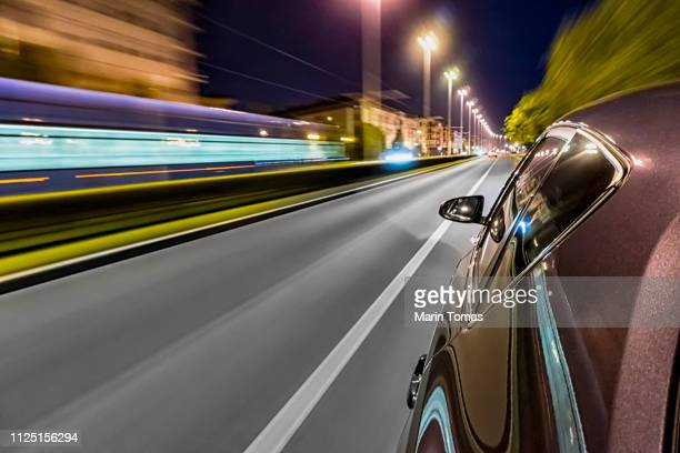 driving a car at night - zoom background stock pictures, royalty-free photos & images