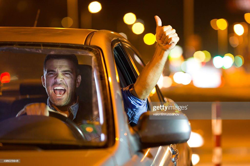 Driving a car at night : Stock Photo