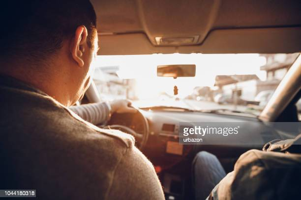driving a car - co pilot stock photos and pictures