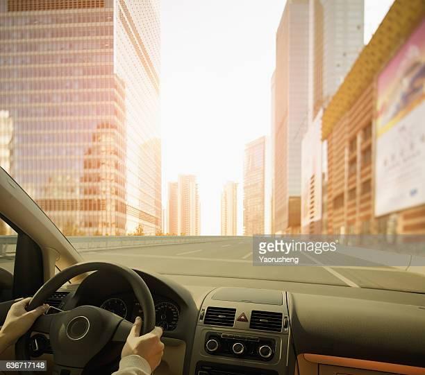 Driving a car to a modem city,Shanghai