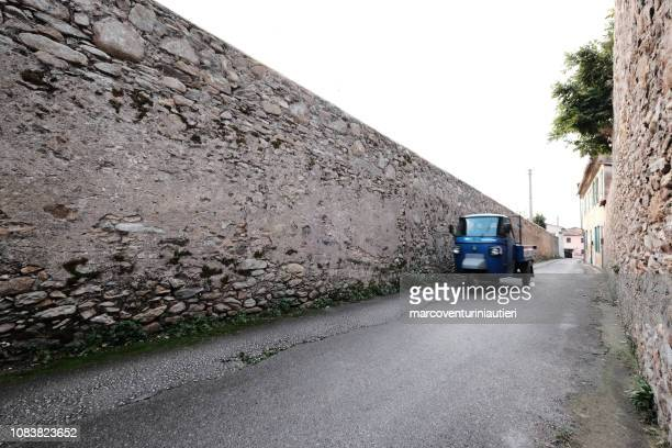 driving a Piaggio Ape in a country road