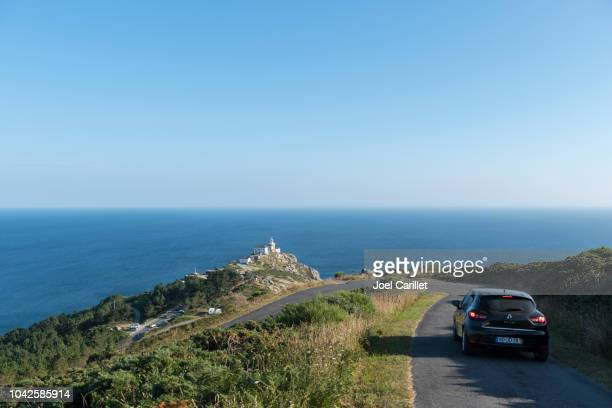 driving a rental car at cape finisterre lighthouse in galicia, spain - renault stock pictures, royalty-free photos & images